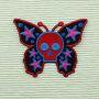 Parche - Calavera Mariposa rojo lila azul