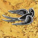 Parche - Golondrina - negro-blanco - Cabeza a la derecha